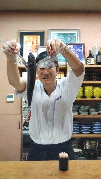 The chef demonstrating how the fish would fly